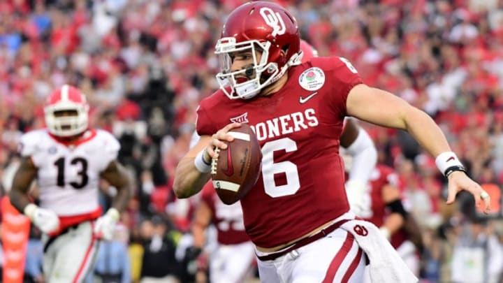 PASADENA, CA - JANUARY 01: Baker Mayfield #6 of the Oklahoma Sooners rushes out of the pocket during the third quarter in the 2018 College Football Playoff Semifinal Game against the Georgia Bulldogs at the Rose Bowl Game presented by Northwestern Mutual at the Rose Bowl on January 1, 2018 in Pasadena, California. (Photo by Harry How/Getty Images)
