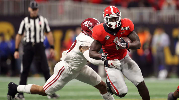 ATLANTA, GA – JANUARY 08: Sony Michel #1 of the Georgia Bulldogs is tackled by Christian Miller #47 of the Alabama Crimson Tide during the second half in the CFP National Championship presented by AT&T at Mercedes-Benz Stadium on January 8, 2018 in Atlanta, Georgia. (Photo by Christian Petersen/Getty Images)