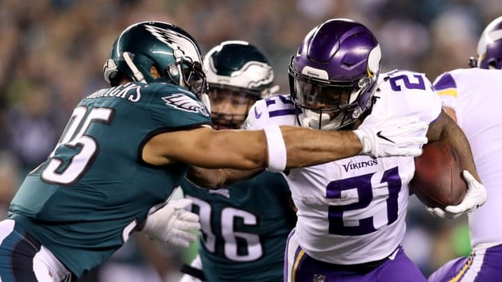 PHILADELPHIA, PA - JANUARY 21: Jerick McKinnon #21 of the Minnesota Vikings uses a stiff arm on Mychal Kendricks #95 of the Philadelphia Eagles during the first quarter in the NFC Championship game at Lincoln Financial Field on January 21, 2018 in Philadelphia, Pennsylvania. (Photo by Patrick Smith/Getty Images)