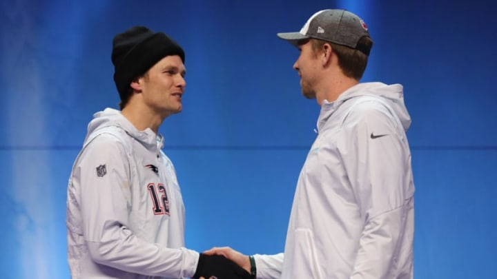 ST PAUL, MN - JANUARY 29: Tom Brady #12 of the New England Patriots and Nick Foles #9 of the Philadelphia Eagles shake hands during Super Bowl Media Day at Xcel Energy Center on January 29, 2018 in St Paul, Minnesota. Super Bowl LII will be played between the New England Patriots and the Philadelphia Eagles on February 4. (Photo by Elsa/Getty Images)