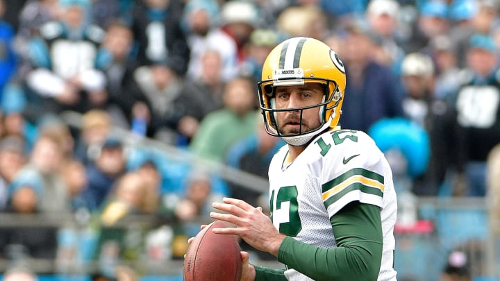 CHARLOTTE, NC – DECEMBER 17: Aaron Rodgers #12 of the Green Bay Packers drops back to pass against the Carolina Panthers during their game at Bank of America Stadium on December 17, 2017 in Charlotte, North Carolina. (Photo by Grant Halverson/Getty Images)