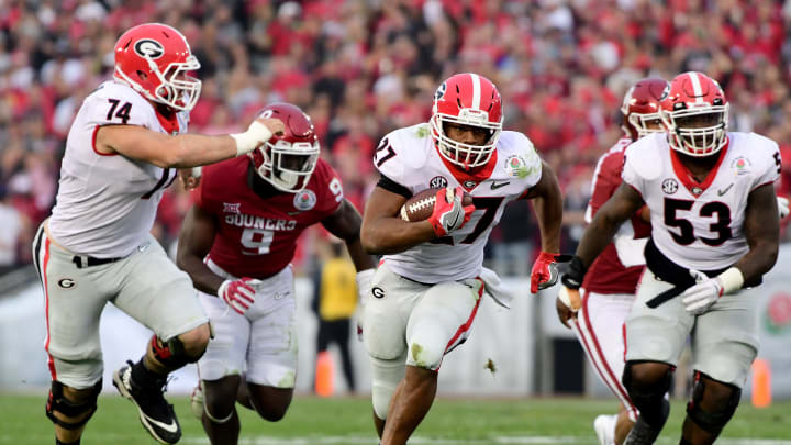 PASADENA, CA – JANUARY 01: Nick Chubb #27 of the Georgia Bulldogs runs for a 50 yard touchdown during the third quarter in the 2018 College Football Playoff Semifinal Game against the Oklahoma Sooners at the Rose Bowl Game presented by Northwestern Mutual at the Rose Bowl on January 1, 2018 in Pasadena, California. (Photo by Harry How/Getty Images)