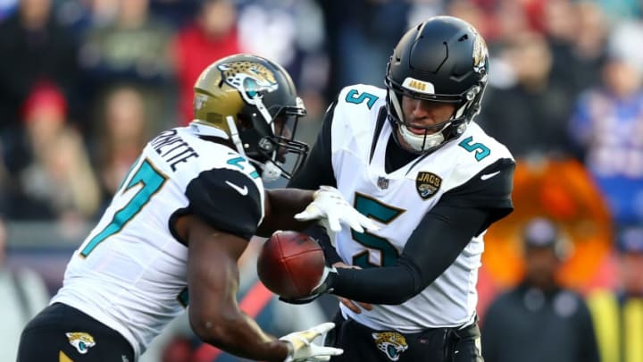 FOXBOROUGH, MA - JANUARY 21: Blake Bortles #5 of the Jacksonville Jaguars hands the ball offsides to Leonard Fournette #27 in the second half during the AFC Championship Game against the New England Patriots at Gillette Stadium on January 21, 2018 in Foxborough, Massachusetts. (Photo by Adam Glanzman/Getty Images)
