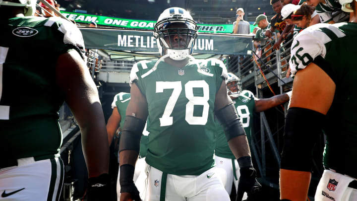 EAST RUTHERFORD, NJ – SEPTEMBER 24: Jonotthan Harrison #78 of the New York Jets walk out of the tunnel prior to an NFL game against the Miami Dolphins at MetLife Stadium on September 24, 2017 in East Rutherford, New Jersey. (Photo by Al Bello/Getty Images)