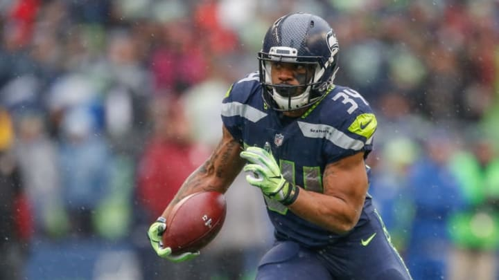 SEATTLE, WA - NOVEMBER 05: Running back Thomas Rawls #34 of the Seattle Seahawks rushes against the Washington Redskins at CenturyLink Field on November 5, 2017 in Seattle, Washington. (Photo by Otto Greule Jr/Getty Images)