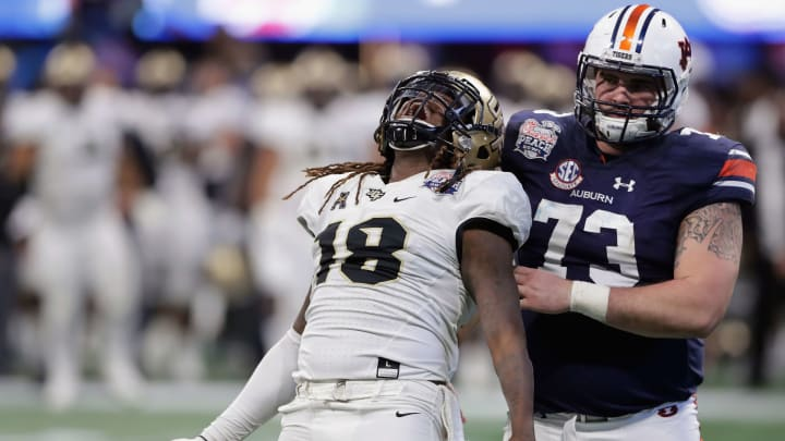 ATLANTA, GA – JANUARY 01: Shaquem Griffin #18 of the UCF Knights celebrates after sacking Jarrett Stidham #8 of the Auburn Tigers (not pictured) in the third quarter during the Chick-fil-A Peach Bowl at Mercedes-Benz Stadium on January 1, 2018 in Atlanta, Georgia. (Photo by Streeter Lecka/Getty Images)