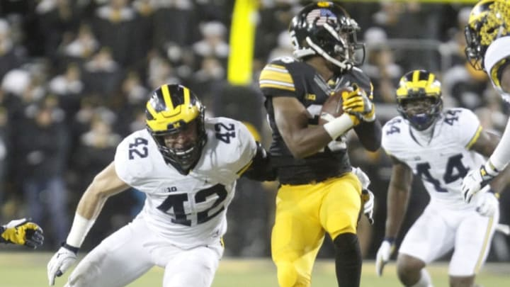 IOWA CITY, IOWA- NOVEMBER 12: Linebacker Ben Gedeon #42 of the Michigan Wolverines makes a tackle during the first quarter on running back Akrum Wadley #25 of the Iowa Hawkeyes on November 12, 2016 at Kinnick Stadium in Iowa City, Iowa. (Photo by Matthew Holst/Getty Images)