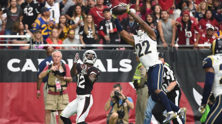 GLENDALE, AZ – OCTOBER 02: Cornerback Trumaine Johnson #22 of the Los Angeles Rams intercepts the football intended for wide receiver John Brown #12 of the Arizona Cardinals during the first half of the NFL game at University of Phoenix Stadium on October 2, 2016 in Glendale, Arizona. (Photo by Norm Hall/Getty Images)