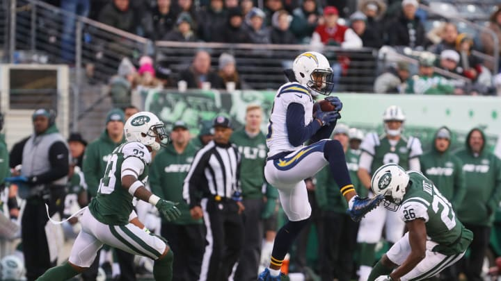 EAST RUTHERFORD, NJ – DECEMBER 24: Keenan Allen #13 of the Los Angeles Chargers makes the catch under pressure from Jamal Adams #33 and Marcus Maye #26 of the New York Jets during the second half of an NFL game at MetLife Stadium on December 24, 2017 in East Rutherford, New Jersey. The Los Angeles Chargers defeated the New York Jets 14-7. (Photo by Ed Mulholland/Getty Images)