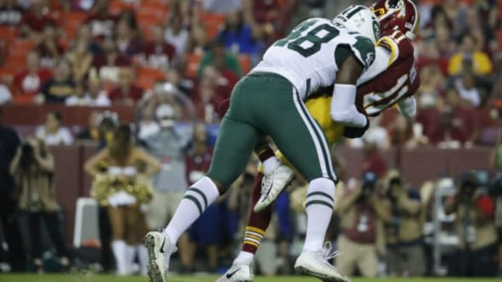 LANDOVER, MD – AUGUST 16: Quarterback Alex Smith #11 of the Washington Redskins is hit by linebacker Jordan Jenkins #48 of the New York Jets after passing the ball in the first quarter of a preseason game at FedExField on August 16, 2018 in Landover, Maryland. Jenkins was assessed a roughing the passer penalty on the play. (Photo by Patrick McDermott/Getty Images)