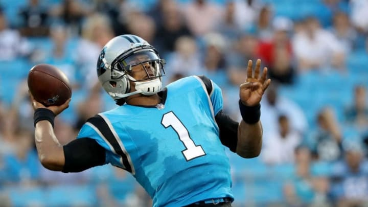 CHARLOTTE, NC - AUGUST 24: Cam Newton #1 of the Carolina Panthers throws a pass against the New England Patriots in the first quarter during their game at Bank of America Stadium on August 24, 2018 in Charlotte, North Carolina. (Photo by Streeter Lecka/Getty Images)