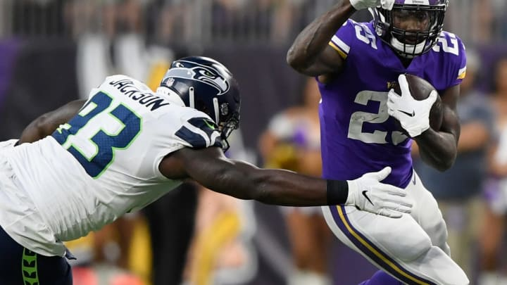 MINNEAPOLIS, MN – AUGUST 24: Latavius Murray #25 of the Minnesota Vikings carries the ball against Branden Jackson #93 of the Seattle Seahawks during the first quarter in the preseason game on August 24, 2018 at US Bank Stadium in Minneapolis, Minnesota. (Photo by Hannah Foslien/Getty Images)