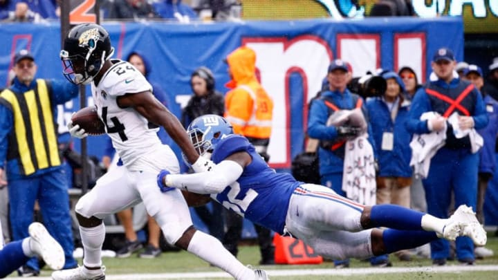 EAST RUTHERFORD, NJ - SEPTEMBER 09: T.J. Yeldon #24 of the Jacksonville Jaguars runs with the ball in the second quarter against Alec Ogletree #52 of the New York Giants at MetLife Stadium on September 9, 2018 in East Rutherford, New Jersey. (Photo by Jeff Zelevansky/Getty Images)