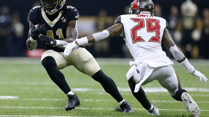 NEW ORLEANS, LA – SEPTEMBER 09: Alvin Kamara #41 of the New Orleans Saints runs with the ball as Ryan Smith #29 of the Tampa Bay Buccaneers defends during the first half at the Mercedes-Benz Superdome on September 9, 2018 in New Orleans, Louisiana. (Photo by Jonathan Bachman/Getty Images)