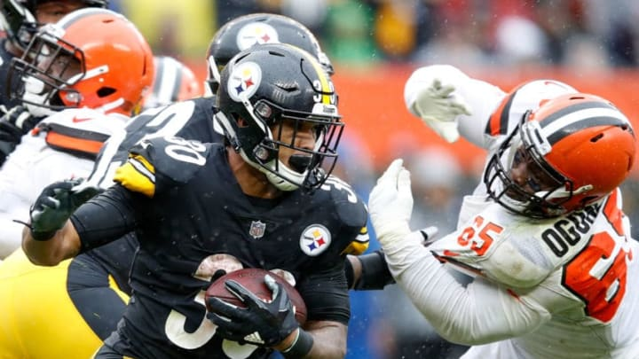 CLEVELAND, OH - SEPTEMBER 09: James Conner #30 of the Pittsburgh Steelers carries the ball in front of Larry Ogunjobi #65 of the Cleveland Browns during the third quarter at FirstEnergy Stadium on September 9, 2018 in Cleveland, Ohio. (Photo by Joe Robbins/Getty Images)