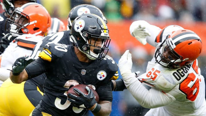 CLEVELAND, OH – SEPTEMBER 09: James Conner #30 of the Pittsburgh Steelers carries the ball in front of Larry Ogunjobi #65 of the Cleveland Browns during the third quarter at FirstEnergy Stadium on September 9, 2018 in Cleveland, Ohio. (Photo by Joe Robbins/Getty Images)