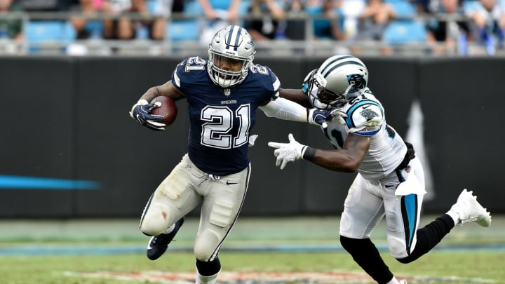 CHARLOTTE, NC – SEPTEMBER 09: Ezekiel Elliott #21 of the Dallas Cowboys runs the ball against Da'Norris Searcy #21 of the Carolina Panthers in the third quarter during their game at Bank of America Stadium on September 9, 2018 in Charlotte, North Carolina. (Photo by Grant Halverson/Getty Images)