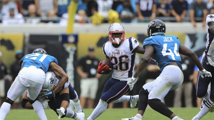 JACKSONVILLE, FL – SEPTEMBER 16: Sony Michel #26 of the New England Patriots runs with the ball in the first half against the Jacksonville Jaguars at TIAA Bank Field on September 16, 2018 in Jacksonville, Florida. (Photo by Sam Greenwood/Getty Images)