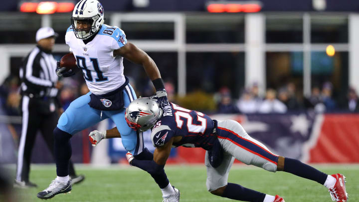 FOXBOROUGH, MA – JANUARY 13: Jonnu Smith #81 of the Tennessee Titans carries the ball after a catch as he is defended by Eric Rowe #25 of the New England Patriots in the second quarter of the AFC Divisional Playoff game at Gillette Stadium on January 13, 2018 in Foxborough, Massachusetts. (Photo by Maddie Meyer/Getty Images)
