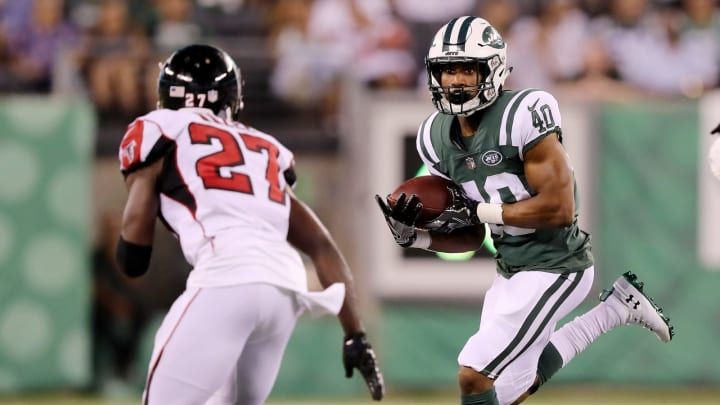 EAST RUTHERFORD, NJ – AUGUST 10: Trenton Cannon #40 of the New York Jets carries the ball as Damontae Kazee #27 of the Atlanta Falcons defends during a preseason game at MetLife Stadium on August 10, 2018 in East Rutherford, New Jersey. (Photo by Elsa/Getty Images)