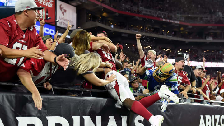 GLENDALE, AZ – SEPTEMBER 30: Wide receiver Chad Williams #10 of the Arizona Cardinals celebrates with fans after scoring a 22-yard touchdown during the fourth quarter against the Seattle Seahawks at State Farm Stadium on September 30, 2018 in Glendale, Arizona. (Photo by Norm Hall/Getty Images)