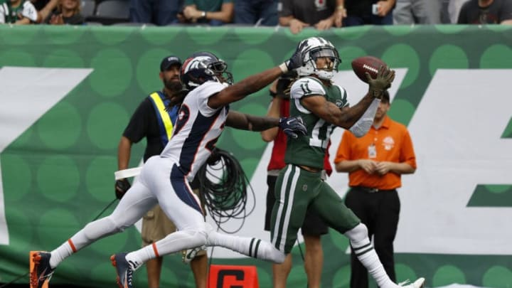 EAST RUTHERFORD, NEW JERSEY - OCTOBER 07: Robby Anderson #11 of the New York Jets scores a 35 yard touchdown against Bradley Roby #29 of the Denver Broncos during the second quarter in the game at MetLife Stadium on October 07, 2018 in East Rutherford, New Jersey. (Photo by Michael Owens/Getty Images)