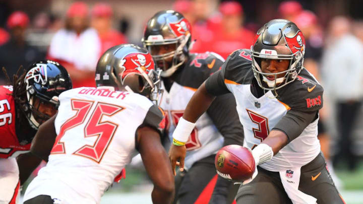 ATLANTA, GA - OCTOBER 14: Jameis Winston #3 of the Tampa Bay Buccaneers hands the ball to Peyton Barber #25 of the Tampa Bay Buccaneers during the first quarter against the Atlanta Falcons at Mercedes-Benz Stadium on October 14, 2018 in Atlanta, Georgia. (Photo by Scott Cunningham/Getty Images)