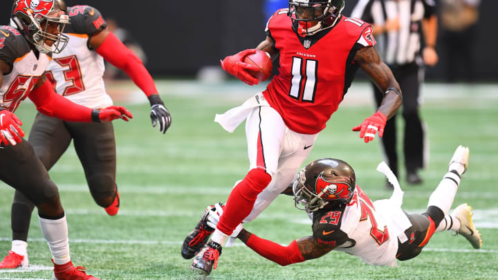 ATLANTA, GA – OCTOBER 14: Julio Jones #11 of the Atlanta Falcons is tackled by Ryan Smith #29 of the Tampa Bay Buccaneers during the first quarter against the Tampa Bay Buccaneers at Mercedes-Benz Stadium on October 14, 2018 in Atlanta, Georgia. (Photo by Scott Cunningham/Getty Images)