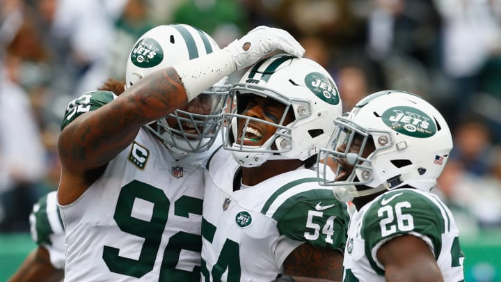 EAST RUTHERFORD, NJ – OCTOBER 14: Inside linebacker Avery Williamson #54 of the New York Jets celebrates with teammates defensive end Leonard Williams #92 and free safety Marcus Maye #26 after breaking up a pass in the endzone on a third own against the Indianapolis Colts during the second quarter at MetLife Stadium on October 14, 2018 in East Rutherford, New Jersey. (Photo by Mike Stobe/Getty Images)