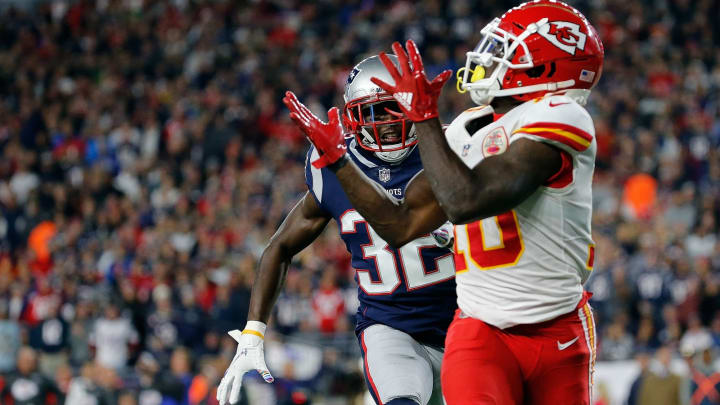 FOXBOROUGH, MA – OCTOBER 14: Tyreek Hill #10 of the Kansas City Chiefs catches a touchdown pass against the defense of Devin McCourty #32 of the New England Patriots in the third quarter at Gillette Stadium on October 14, 2018 in Foxborough, Massachusetts. (Photo by Jim Rogash/Getty Images)