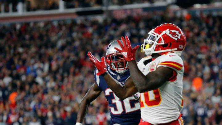 FOXBOROUGH, MA - OCTOBER 14: Tyreek Hill #10 of the Kansas City Chiefs catches a touchdown pass against the defense of Devin McCourty #32 of the New England Patriots in the third quarter at Gillette Stadium on October 14, 2018 in Foxborough, Massachusetts. (Photo by Jim Rogash/Getty Images)