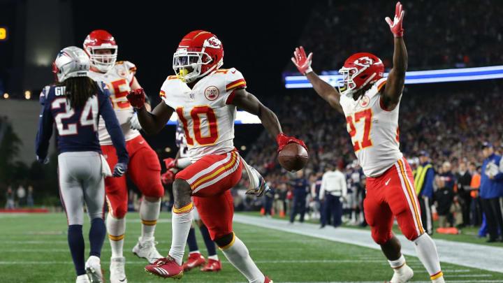 FOXBOROUGH, MA – OCTOBER 14: Tyreek Hill #10 of the Kansas City Chiefs celebrates a touchdown pass with Kareem Hunt #27 of the Kansas City Chiefs against the New England Patriots in the fourth quarter at Gillette Stadium on October 14, 2018 in Foxborough, Massachusetts. (Photo by Jim Rogash/Getty Images)