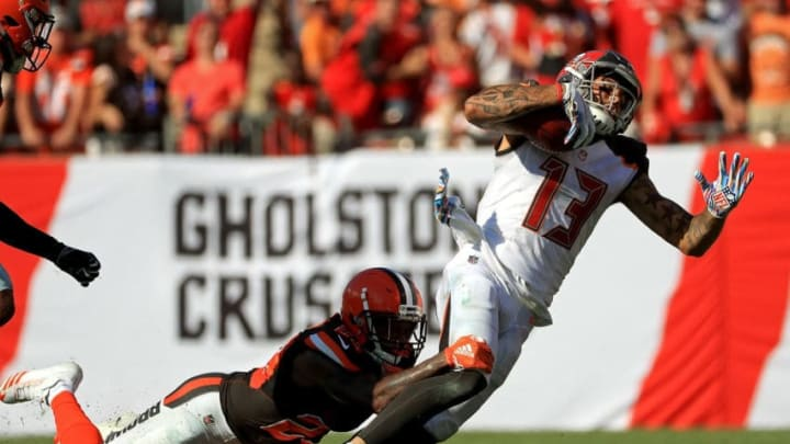 TAMPA, FL - OCTOBER 21: Mike Evans #13 of the Tampa Bay Buccaneers makes a catch during a game against the Cleveland Browns at Raymond James Stadium on October 21, 2018 in Tampa, Florida. (Photo by Mike Ehrmann/Getty Images)
