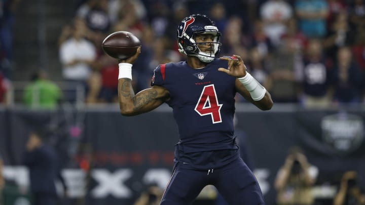 HOUSTON, TX – OCTOBER 25: Deshaun Watson #4 of the Houston Texans sets up to pass against the Miami Dolphins in the first quarter at NRG Stadium on October 25, 2018 in Houston, Texas. (Photo by Tim Warner/Getty Images)