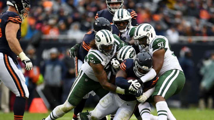CHICAGO, IL - OCTOBER 28: Jordan Howard #24 of the Chicago Bears is tackled by the New York Jets in the fourth quarter at Soldier Field on October 28, 2018 in Chicago, Illinois. (Photo by Stacy Revere/Getty Images)