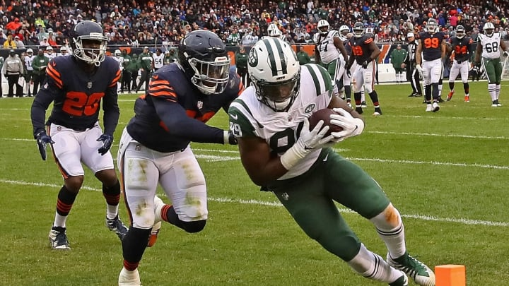 CHICAGO, IL – OCTOBER 28: Chris Herndon #89 of the New York Jets dives into the end zone to score a touchdown as Roquan Smith #58 of the Chicago Bears chases at Soldier Field on October 28, 2018 in Chicago, Illinois. The Bears defeated the Jets 24-10. (Photo by Jonathan Daniel/Getty Images)