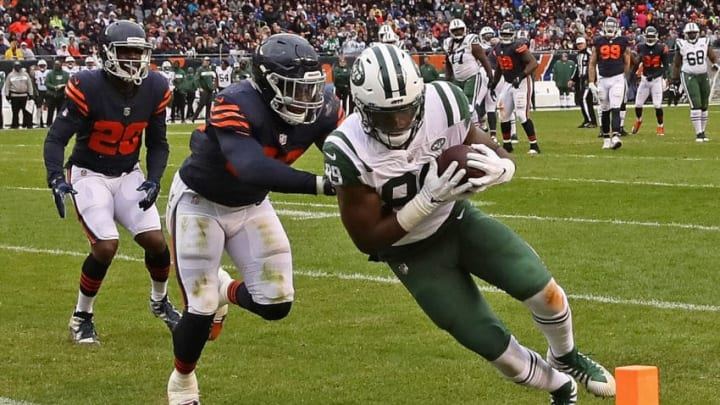 CHICAGO, IL - OCTOBER 28: Chris Herndon #89 of the New York Jets dives into the end zone to score a touchdown as Roquan Smith #58 of the Chicago Bears chases at Soldier Field on October 28, 2018 in Chicago, Illinois. The Bears defeated the Jets 24-10. (Photo by Jonathan Daniel/Getty Images)
