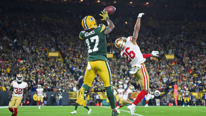 GREEN BAY, WI – OCTOBER 15: Davante Adams #17 of the Green Bay Packers catches a pass for a touchdown in front of Greg Mabin #26 of the San Francisco 49ers during the second half at Lambeau Field on October 15, 2018 in Green Bay, Wisconsin. (Photo by Stacy Revere/Getty Images)