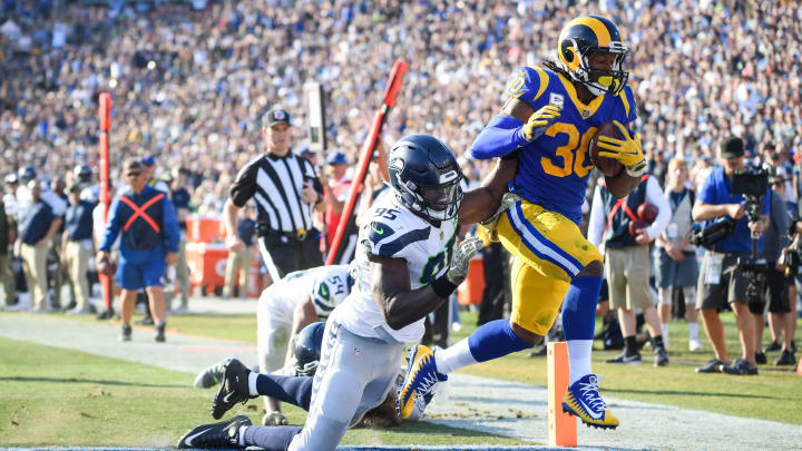 LOS ANGELES, CA – NOVEMBER 11: Running back Todd Gurley #30 of the Los Angeles Rams scores a touchdown in front of defensive end Dion Jordan #95 of the Seattle Seahawks to take a 17-14 lead in the second quarter at Los Angeles Memorial Coliseum on November 11, 2018 in Los Angeles, California. (Photo by Harry How/Getty Images)