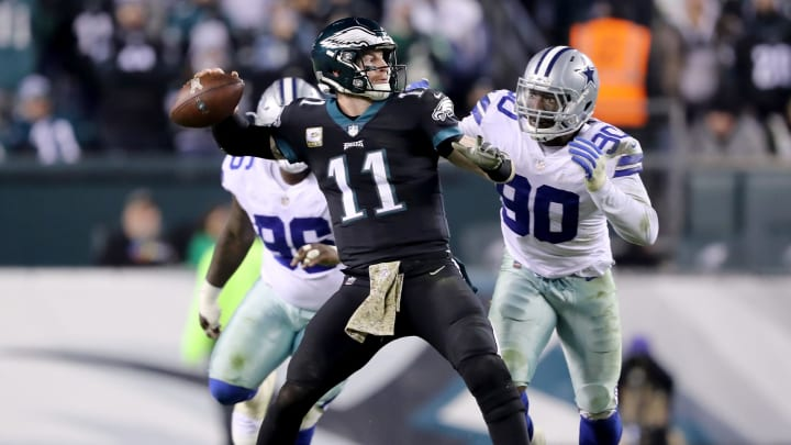 PHILADELPHIA, PA – NOVEMBER 11: Carson Wentz #11 of the Philadelphia Eagles is pressured by Demarcus Lawrence #90 and Maliek Collins #96 of the Dallas Cowboys on November 11,2018 at Lincoln Financial Field in Philadelphia, Pennsylvania. (Photo by Elsa/Getty Images)