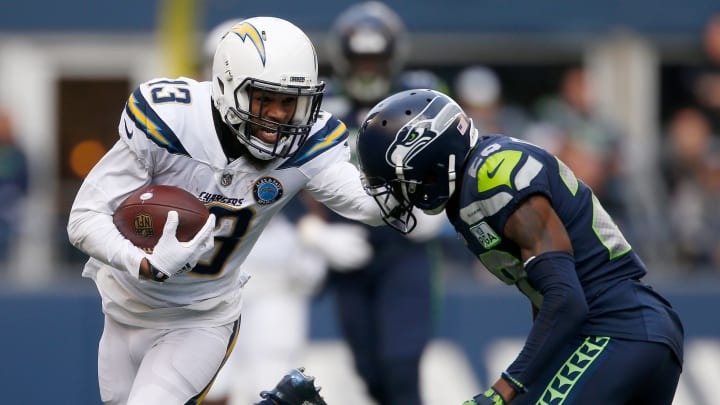 SEATTLE, WASHINGTON – NOVEMBER 04: Keenan Allen #13 of the Los Angeles Chargers runs with the ball while being tackled by Justin Coleman #28 of the Seattle Seahawks in the second quarter at CenturyLink Field on November 04, 2018 in Seattle, Washington. (Photo by Otto Greule Jr/Getty Images)