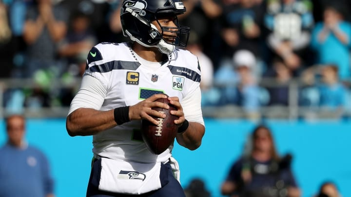 CHARLOTTE, NC – NOVEMBER 25: Russell Wilson #3 of the Seattle Seahawks throws a pass against the Carolina Panthers in the first quarter during their game at Bank of America Stadium on November 25, 2018 in Charlotte, North Carolina. (Photo by Streeter Lecka/Getty Images)