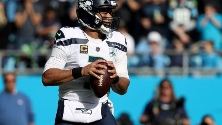 CHARLOTTE, NC - NOVEMBER 25: Russell Wilson #3 of the Seattle Seahawks throws a pass against the Carolina Panthers in the first quarter during their game at Bank of America Stadium on November 25, 2018 in Charlotte, North Carolina. (Photo by Streeter Lecka/Getty Images)