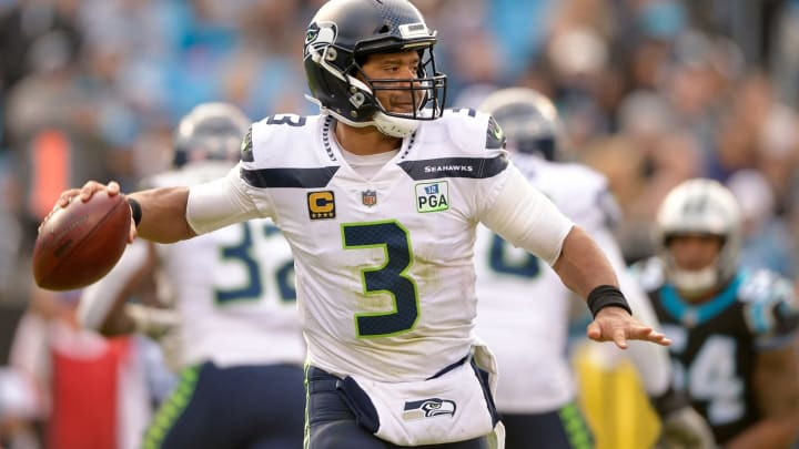 CHARLOTTE, NC – NOVEMBER 25: Russell Wilson #3 of the Seattle Seahawks rolls out against the Carolina Panthers during the first half of their game at Bank of America Stadium on November 25, 2018 in Charlotte, North Carolina. (Photo by Grant Halverson/Getty Images)