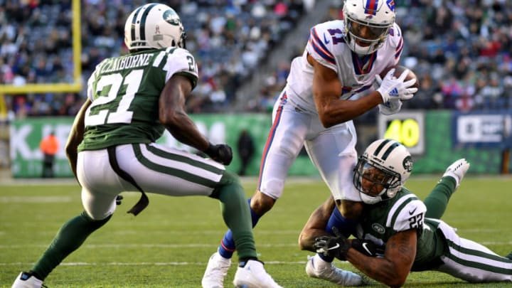 EAST RUTHERFORD, NEW JERSEY - NOVEMBER 11: Zay Jones #11 of the Buffalo Bills runs the ball against Morris Claiborne #21 and Trumaine Johnson #22 of the New York Jets during the third quarter at MetLife Stadium on November 11, 2018 in East Rutherford, New Jersey. (Photo by Mark Brown/Getty Images)