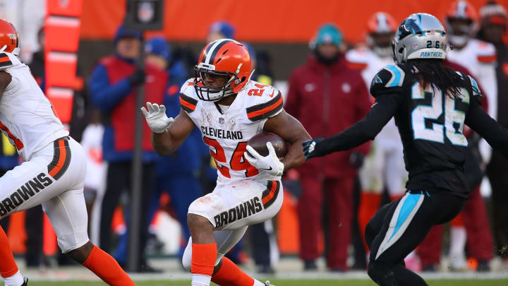 CLEVELAND, OH – DECEMBER 09: Nick Chubb #24 of the Cleveland Browns carries the ball in front of Donte Jackson #26 of the Carolina Panthers during the fourth quarter at FirstEnergy Stadium on December 9, 2018 in Cleveland, Ohio. (Photo by Gregory Shamus/Getty Images)