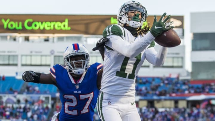 ORCHARD PARK, NY - DECEMBER 09: Robby Anderson #11 of the New York Jets makes a reception out of bounds near the end zone during the fourth quarter against Tre'Davious White #27 of the Buffalo Bills at New Era Field on December 9, 2018 in Orchard Park, New York. New York defeats Buffalo 27-23. (Photo by Brett Carlsen/Getty Images)