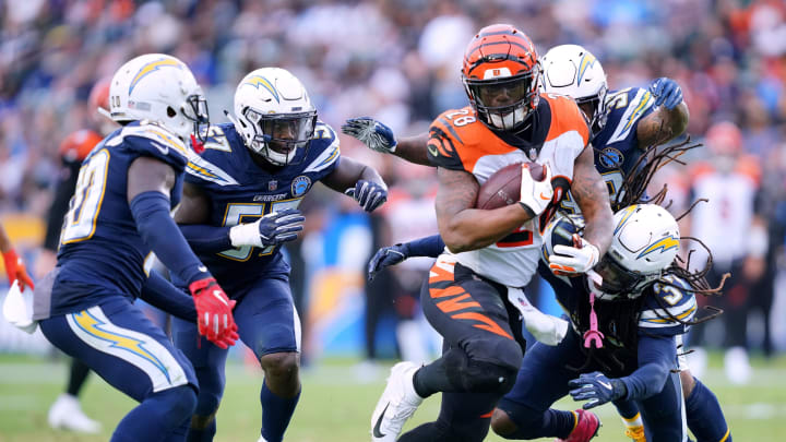 CARSON, CA – DECEMBER 09: Joe Mixon #28 of the Cincinnati Bengals is chased down by Jahleel Addae #37, Desmond King #20 and Jatavis Brown #57 of the Los Angeles Chargers during the fourth quarter in a 26-21 Chargers win at StubHub Center on December 9, 2018 in Carson, California. (Photo by Harry How/Getty Images)