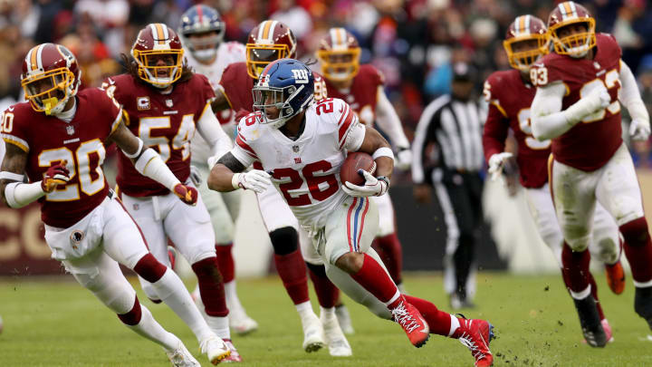 LANDOVER, MD – DECEMBER 09: Running back Saquon Barkley #26 of the New York Giants rushes against the Washington Redskins at FedExField on December 9, 2018 in Landover, Maryland. (Photo by Patrick Smith/Getty Images)