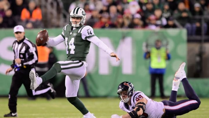 EAST RUTHERFORD, NJ - DECEMBER 15: Quarterback Sam Darnold #14 of the New York Jets escapes a tackle by defensive end J.J. Watt #99 of the Houston Texans during the third quarter at MetLife Stadium on December 15, 2018 in East Rutherford, New Jersey. (Photo by Steven Ryan/Getty Images)